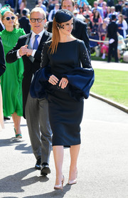 Sarah Rafferty looked sophisticated in a navy Lanvin cocktail dress with bubble sleeves at the wedding of Prince Harry and Meghan Markle.