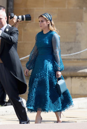 Princess Beatrice complemented her dress with a blue satin purse.