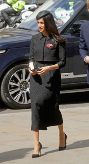 Meghan Markle kept it prim and proper in this black cropped jacket and midi skirt combo by Emilia Wickstead while attending an Anzac Day service.