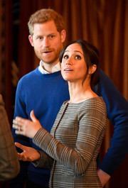 Meghan Markle toured Cardiff Castle wearing an off-the-shoulder glen plaid jacket by Theory.