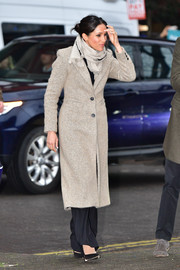 Meghan Markle stopped by Reprezent 107.3 FM wearing a taupe wool coat by Smythe.