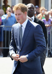 Prince Harry looked dapper in this textured tie and sharp blue suit.