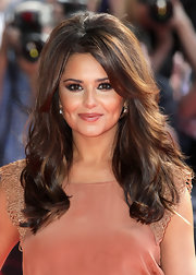 Cheryl Cole gave her look a high impact touch with lengthy lashes.