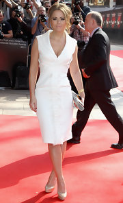 Kimberley Walsh accented her demure white dress with a black-and-white snakeskin clutch.