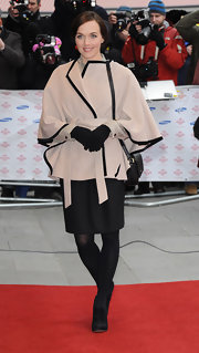 Victoria Pendleton chose a nude, asymmetrical, wool cape with black trim for her elegant red carpet look.