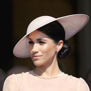 Meghan Markle finished off her look with a pink wide-brimmed hat by Philip Treacy.