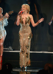 Kylie Minogue was a sight to behold in this heavily beaded strapless gown while performing at the Invest in Futures Gala.