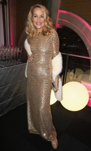 Jerry Hall looked every inch the glamour girl at the Invest in Futures Gala in a gold column dress rendered in wave-patterned sequins.