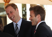Prince William wore a silver and navy striped tie to meet David Beckham.