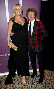 Penny Lancaster carried an elegant clutch at a gala dinner.