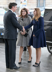 Princess Beatrice paired her navy coat with black pumps.