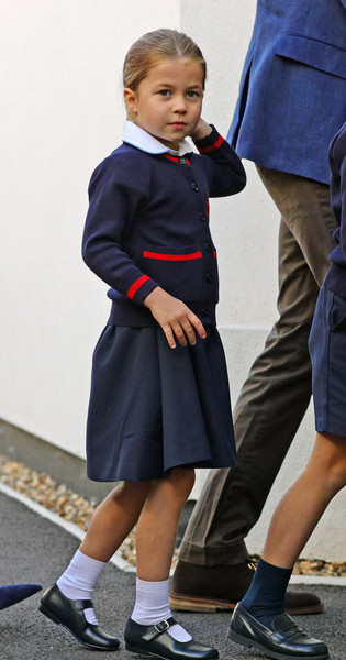 Princess Charlotte looked adorable in navy and red cardigan as she arrived for her first day of school.