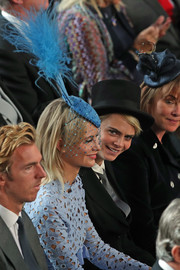 Poppy Delevingne stood out in a feathered blue fascinator by Victoria Grant at Princess Eugenie's wedding.