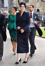 Liv Tyler opted for a simple navy skirt suit by Stella McCartney when she attended Princess Eugenie's wedding.