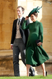 Pippa Middleton donned a long-sleeve green maternity dress by Emilia Wickstead for Princess Eugenie's wedding.