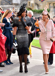 Naomi Campbell made a gorgeous entrance in a feathered cocktail dress by Ralph & Russo at Princess Eugenie's wedding.