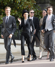 Cara Delevingne went androgynous in a black Emporio Armani tuxedo at Princess Eugenie's wedding.