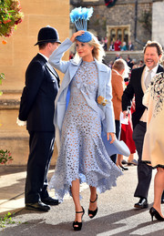 Poppy Delevingne styled her blue outfit with black platform sandals by Christian Louboutin.