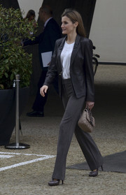 Princess Letizia completed her smart outfit with a pair of gray slacks.