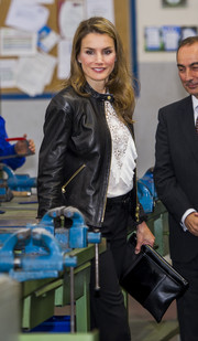 Princess Letizia attended a training course rocking a leather-on-leather clutch and jacket combo.