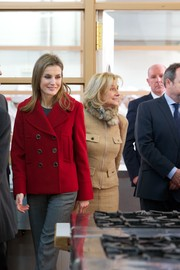 Princess Letizia was casual yet elegant in a red pea coat and gray slacks while touring the Labour University of Albacete.