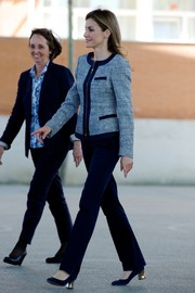 Princess Letizia chose a pair of blue slacks to team with her jacket.