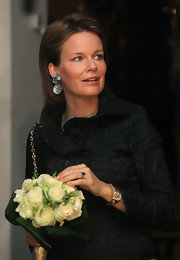 Princess Mathilde wore her hair in a straight mid-length bob with side-part.