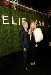 Rachel Zoe glammed up her black Elie Saab jumpsuit with a white fur cape for the label's private dinner in LA.