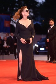 Susan Sarandon put her curves on display in a low-cut, form-fitting black gown by Hugo Boss at the Venice Film Festival premiere of 'The Private Life of a Modern Woman.'