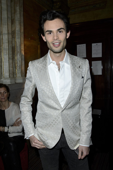 Mark Francis Vandelli shined in a metallic silver blazer while attending an event in London.