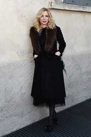 Courtney Love arrived for the 'TV 70: Francesco Vezzoli Guarda La Rai' private view wearing a belted, fur-collar coat over a lace dress.