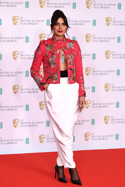Priyanka Chopra-Jonas Harem Pants [footwear,joint,shoe,outerwear,hairstyle,arm,shoulder,leg,neck,sleeve,bikini top,footwear,priyanka chopra jonas,red,joint,ee,england,london,royal albert hall,british academy film awards 2021 - arrivals,helena bonham carter,65th british academy film awards,red carpet,fashion show,fashion,carpet,model,dos gardenias stein square neck bralette bikini top,2012,red]