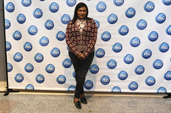 For her footwear, Mindy Kaling chose a pair of stylish black loafers.