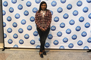 Mindy Kaling completed her outfit with classic black jeans.