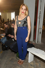Jemima Kirke teamed her top with high-waisted blue pants.
