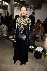 Kate Bosworth teamed her dress with a black chain-strap bag, also by Proenza Schouler.