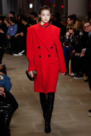 Gigi Hadid looked sophisticated in a double-breasted red coat while walking the Proenza Schouler runway.