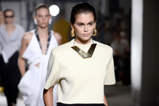 Kaia Gerber showed off a gold statement necklace while walking the Proenza Schouler fashion show.