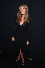 Nina Garcia went for a bit of sparkle with this beaded, carwash-hem LBD during the 'Project Runway' fashion show.