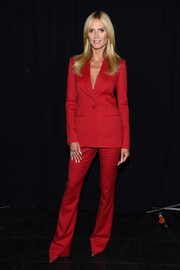 Heidi Klum looked very polished in a red pantsuit by Zac Posen for Brooks Brothers during the 'Project Runway' fashion show.