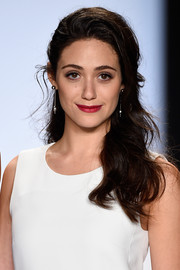 Emmy Rossum added a jolt of color to her white outfit via a sexy red lip.