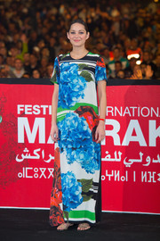 Marion Cotillard stood out in a bright floral maxi dress by Preen at the 'Public Enemies' presentation during the 13th Marrakech International Film Festival.