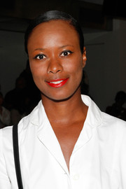 Shala Monroque's bright red lipstick totally lit up her beauty look.