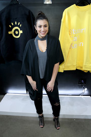 Dana Gaier layered a black shawl-collar cardigan over a gray cutout top for the Puma x Minions collaboration launch.