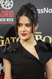 Salma Hayek wore her hair is a sexy, voluminous french twist at the premiere of 'Puss in Boots' in Madrid.