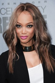 Tyra Banks sported mussed-up, center-parted waves at the Q&A for 'The New Celebrity Apprentice.'