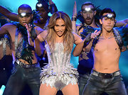 Jennifer Lopez showed some skin at the Q'Viva concert in this silver corseted bodysuit.