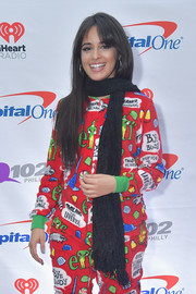 Camila Cabello teamed a black knit scarf with her colorful pajamas for Q102's Jingle Ball 2018.