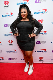 Lizzo donned an off-the-shoulder black denim dress for Q102's Jingle Ball 2019.