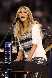 Delta Goodrem dazzled in an embellished top and metallic pants at the ARL State of Origin series.